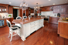stock-photo-8953246-dream-kitchen-dark-hardwood-floors-cabinets-chandelier-marble-granite-counters